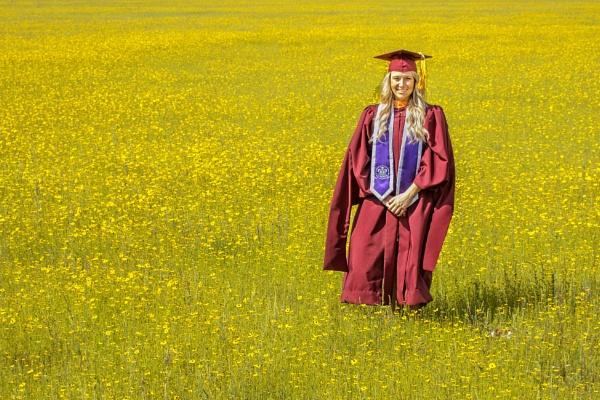 Graduate in a sea of flowers. by jbsaladino