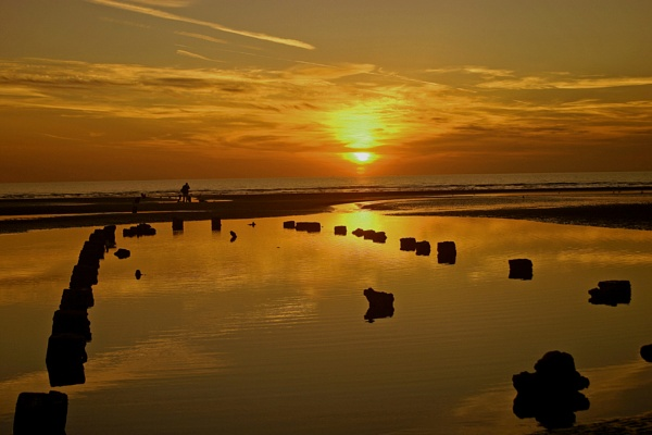 beach sunset by arnieg