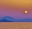 Sun setting Fethije Turkey. by georgiepoolie