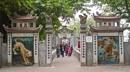 Entrance to the Huc Bridge spanning Hoan Kiem Lake, Hanoi, Vietnam by brian17302