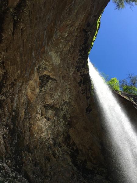 Sun through waterfall by attybrown