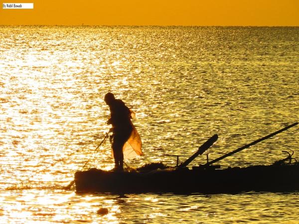 Fishing at sunrise by bulbulov