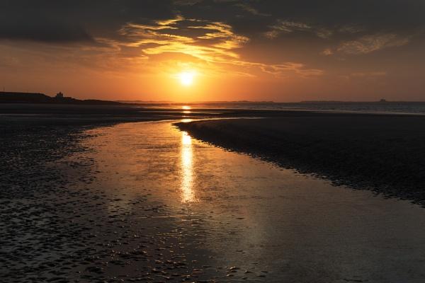 Bamburgh Lighthouse Sunset by Trevhas
