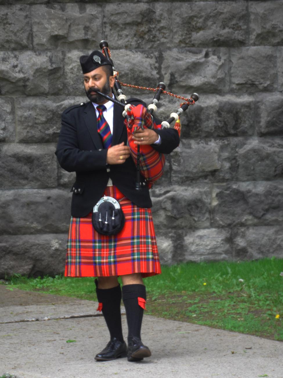 A Bag Pipe Player At McGill University's Undergrad Graduation