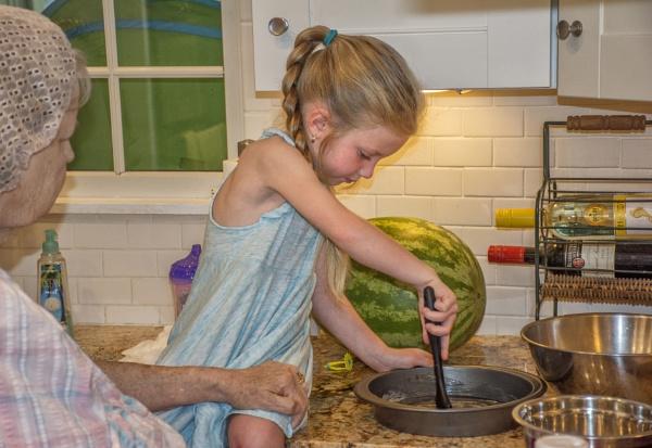 Helping grandma make a cake. by jbsaladino