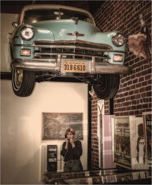 Girl with car on head by KingBee