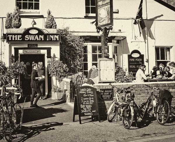 Busy scene at Swann Inn, Lympstone, Devon by starckimages