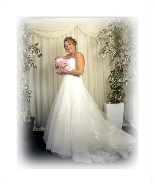 Wedding Photo  Bride holding Niece by r0nn1e