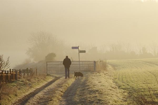 A man walking a dog. by rustyshackleford