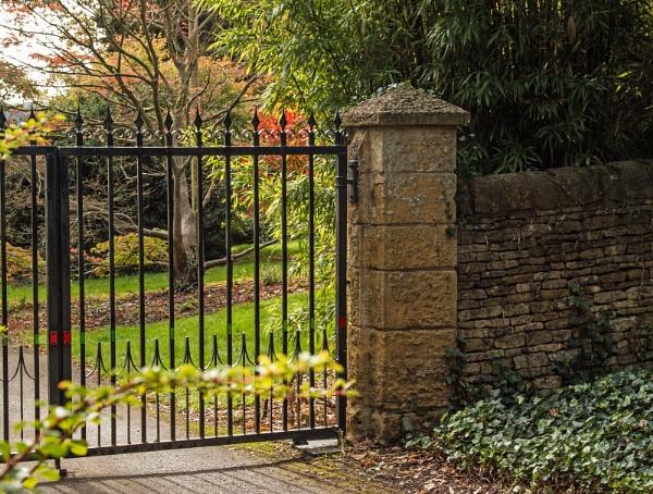 Glimpse Autumn through the gates by Janetdinah