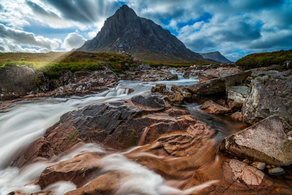 Light,river,rocks,mountain and action by douglasR
