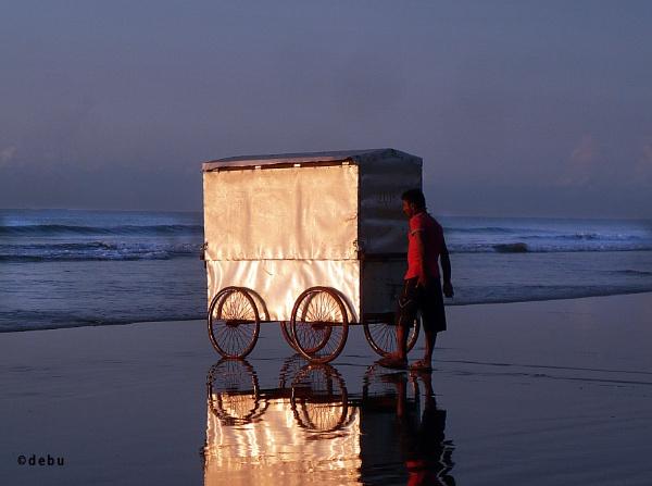 Cyclo van for wash in the sea beach by debu