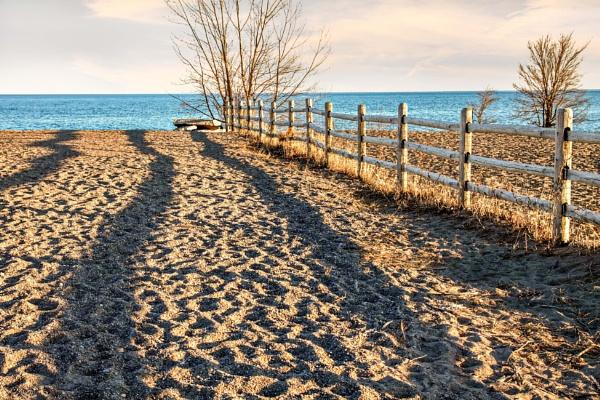 Shadow on  beach by manicam