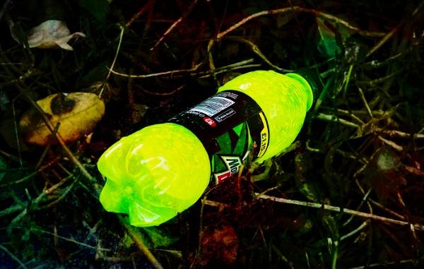 Discarded Luminous Bottle