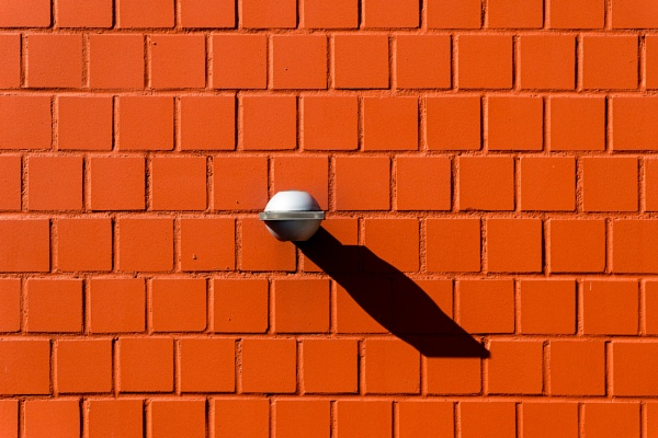 Lamp on brick wall by rninov