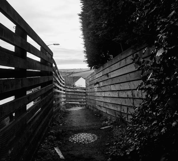 Fenced alleyway by Madoldie