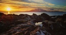 Sunset over Arran from Portencross by paulcookphotography