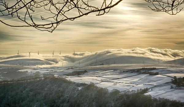 Windfarm in Rolling Mist by iangilmour