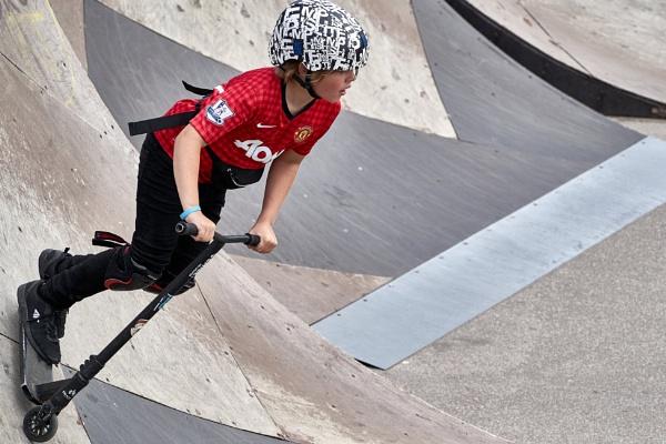 A kick scooter rider by LotaLota