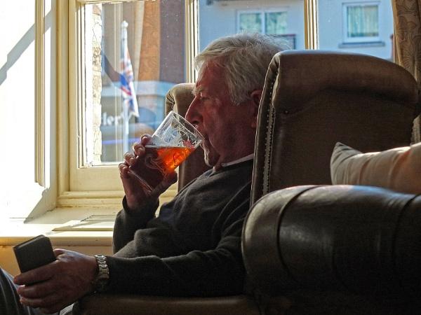 Enjoying a pint. by Mollycat