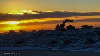 Sunset in a tar sand mine