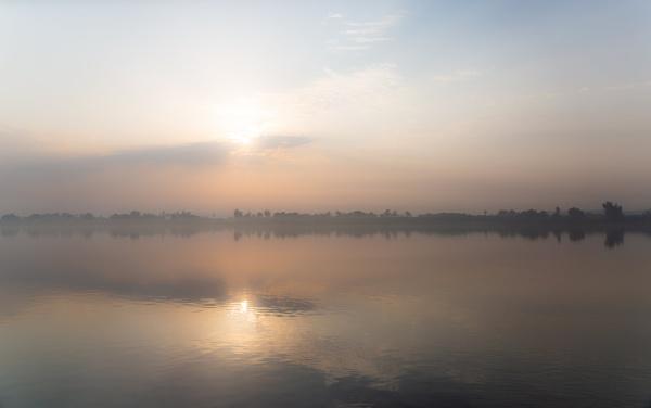 Fog at sunrise on Nile by rninov