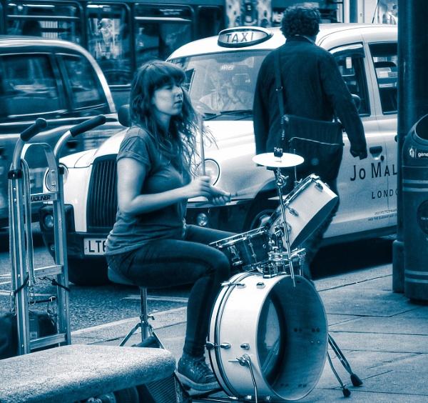 Street musician by KrazyKA