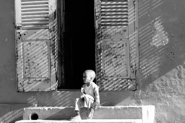 Young boy waiting for his supper -Isle De Goree- Senegal by Backabit