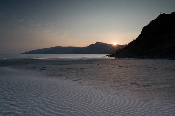 Beach starburst sunset by PhotoLinda