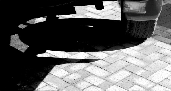 Shadow under a neighbour\'s car by helenlinda