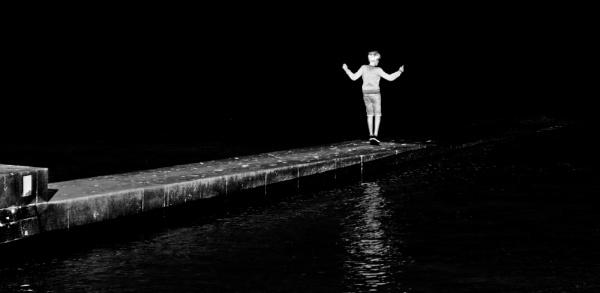 Boy On Breakwater - Lyme Regis by starckimages