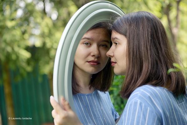 Girl looking in mirror by jordachelr