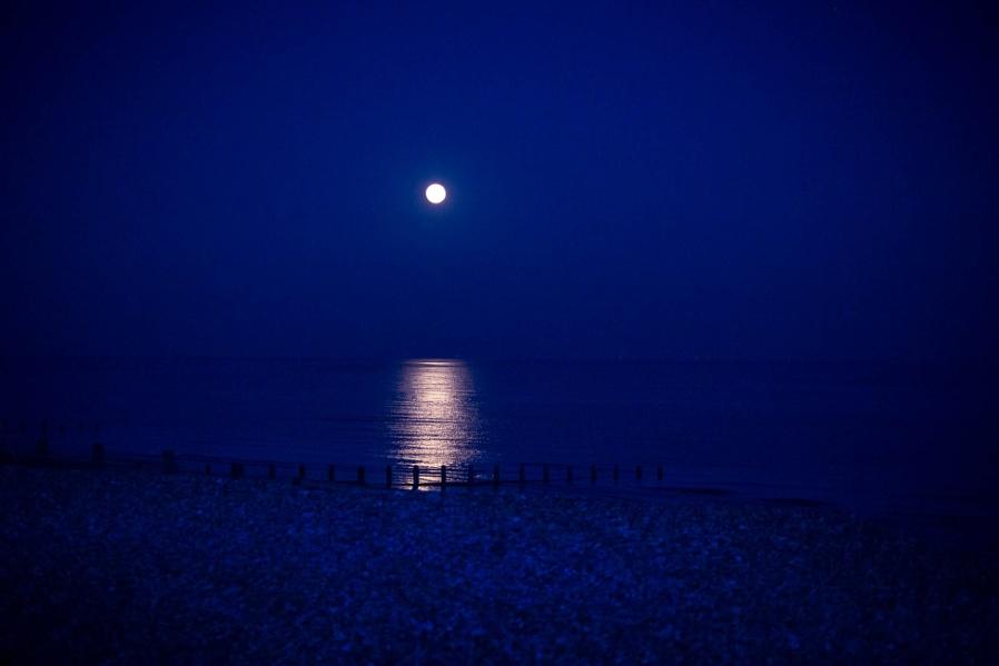 Moon lit pebble beach