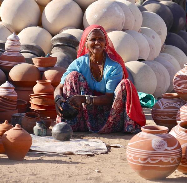 Pushkar pot lady .. by chrisdunham