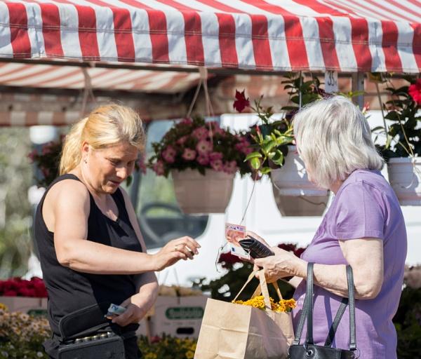 People at the Nummela marketplace . No 1. Saleswoman. by kuvailija