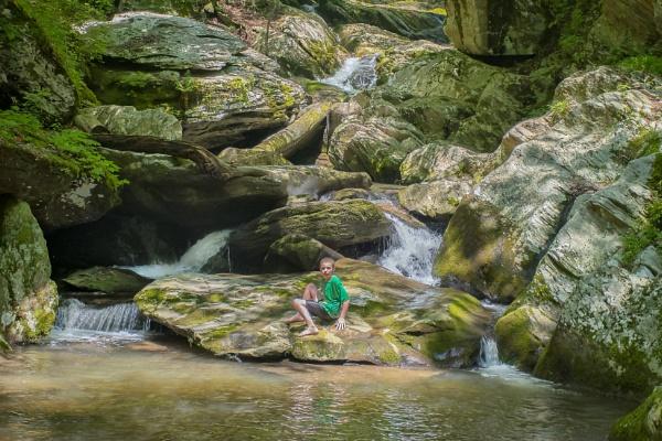 Boy at falls by jbsaladino