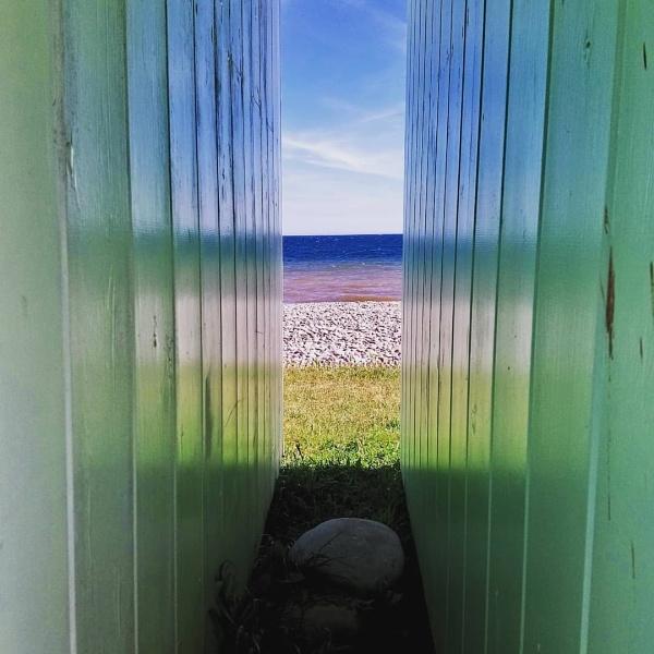 Beach hut reflections by sktimms