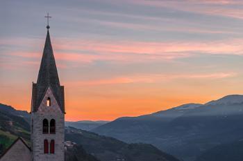 Belfry of the Parish Church in Villanders at Sunrise