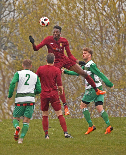 two local teams playing last year  the coloured player in the air is 7 feet tall by krebsbaum