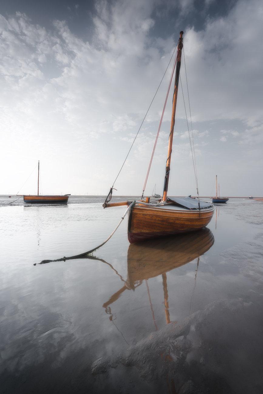 Sailboats at low tide.