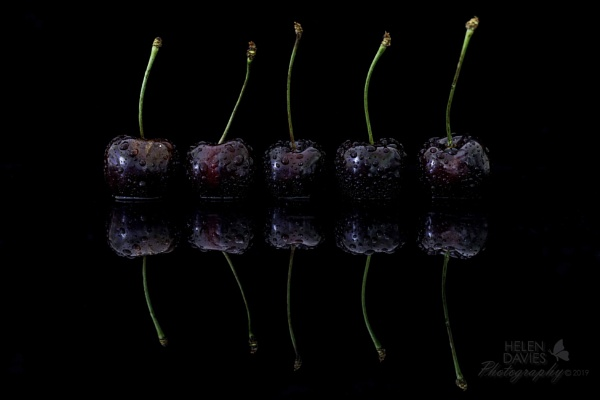 A row of cherries. by 2008
