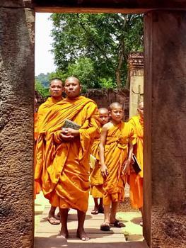 Buddhist monks at awesome Angkor ..