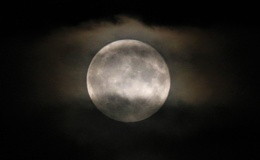 Cloud covered full moon