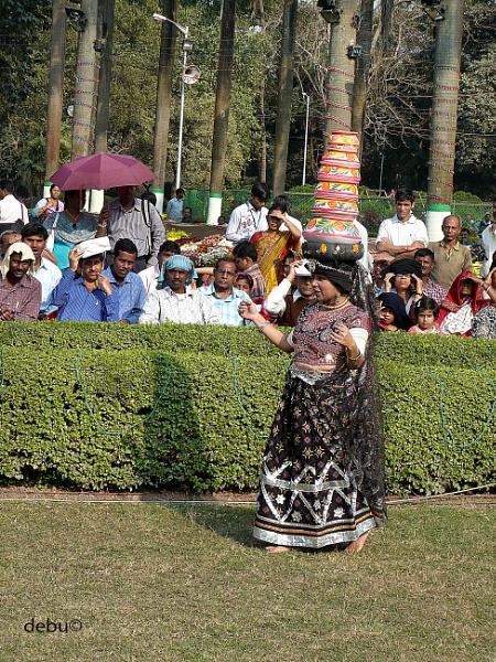 Rajasthani woman balances multiple pots, while dancing by debu