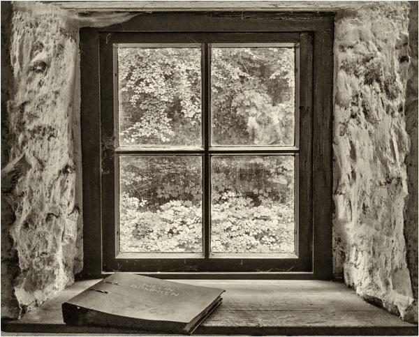 A window in Bompren corn mill. by franken