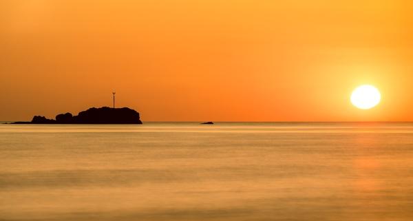 Sun Sea and Rocks by happysnapper