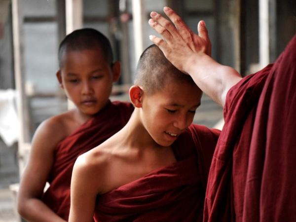 Burmese monk blessing novice .. by chrisdunham