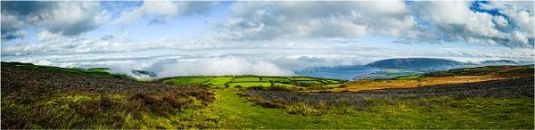 Clouds rolling in over Porlock Weir by Dixxipix