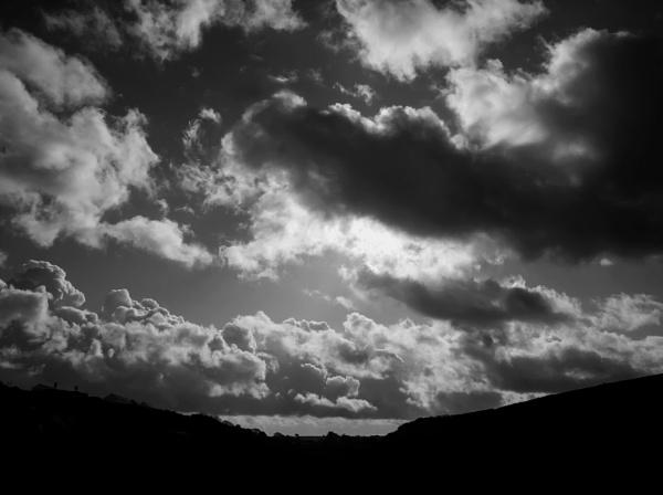Hiding behind clouds by Madoldie