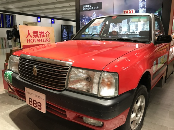 Red taxi in Hong Kong by manicam